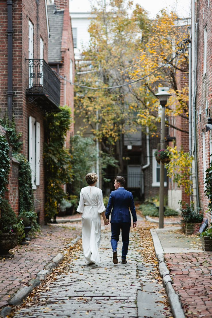 Philly's historic cobblestone streets make a beautiful backdrop for this couple's wedding photos. (Photo by Love Me Do Photography)