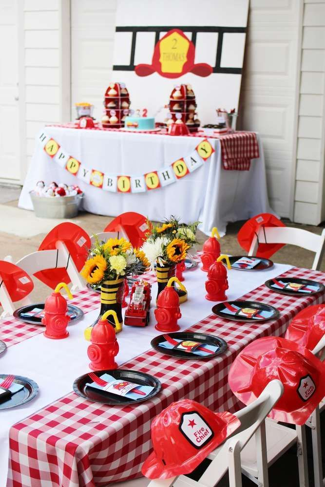 Red and white table at a firefighter birthday party! See more party ideas at CatchMyParty.com!