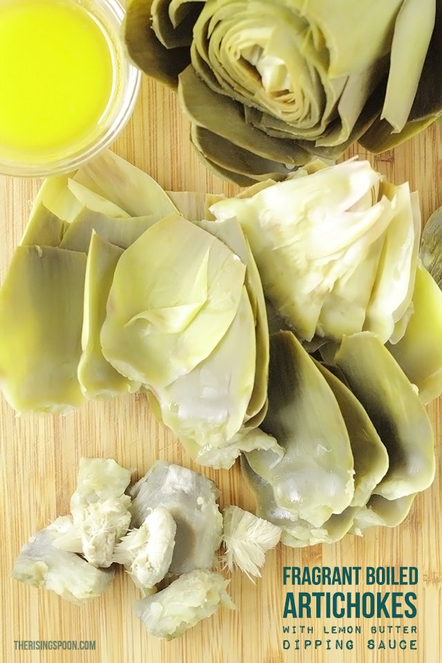 Fragrant Boiled Artichokes with Lemon Butter Dipping Sauce | therisingspoon.com -- What's the easiest way to cook a whole artichoke? Boil it! This no-fail method keeps the meat tender and moist while also infusing the artichoke with fragrant lemon and garlic. Serve with a simple dipping sauce like lemon butter or aioli for a delicious appetizer or main course.