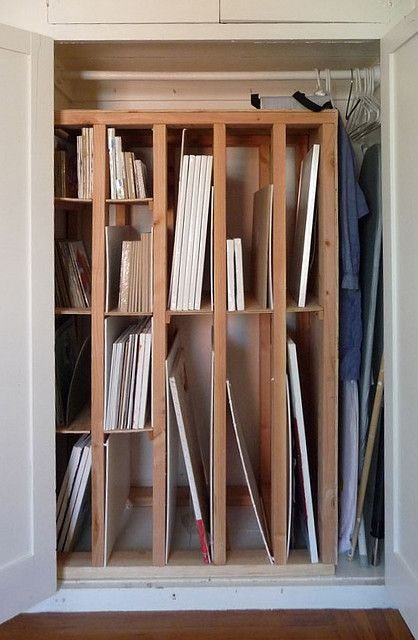 New storage rack for paintings and canvas within a closet area. great idea for artist studio or home office
