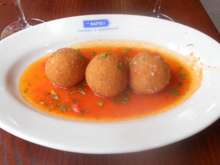 Arancini - fried saffron risotto balls filled with mozzarella and meat ragu from Via Napoli in Epcot