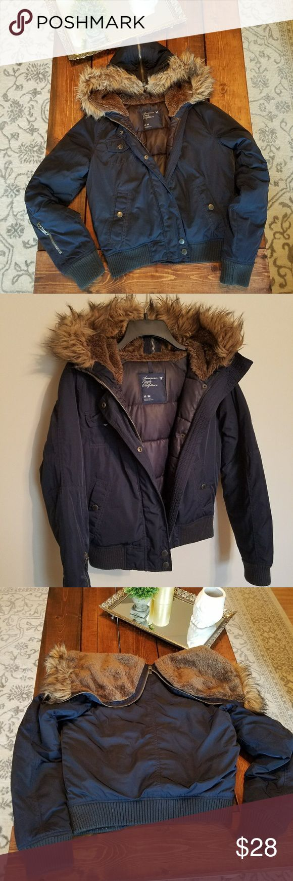American Eagle navy fur puffer jacket Size medium fits like a small. No flaws. Zips and buttons. The hood zips to lay flat if you don't want the hood. I love this jacket ❤ American Eagle Outfitters Jackets & Coats Puffers