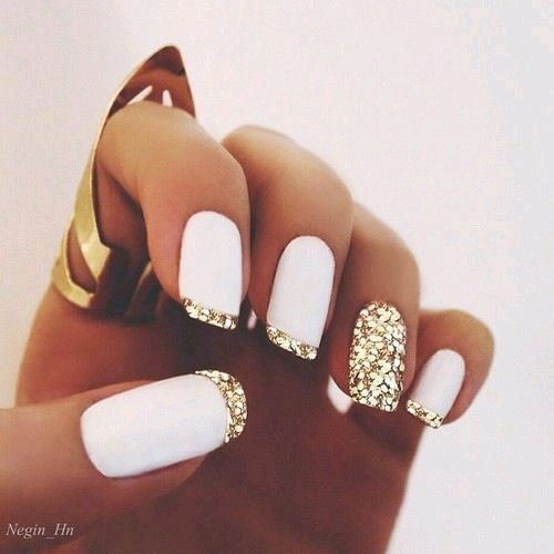 White matte nail polish & glitter french tips put a creative twist on the classic French manicure. This is a classy, yet fun, nail design.