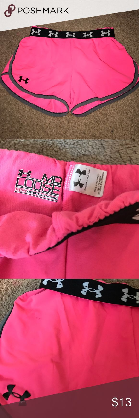 Under Armour hot pink shorts Size medium, great condition. Small spot pictured, bright pink color with grey lining! Plastic under Armour sign so won't have to worry about it peeling off!! Under Armour Shorts