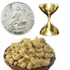 #Diwaligift the combination of dry fruits, sliver laxmi coins, and diya.