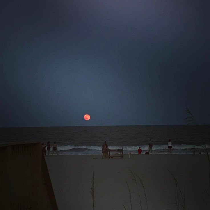 A gorgeous red moon rises over the beach at Palmetto Dunes. Photo via @julzg19