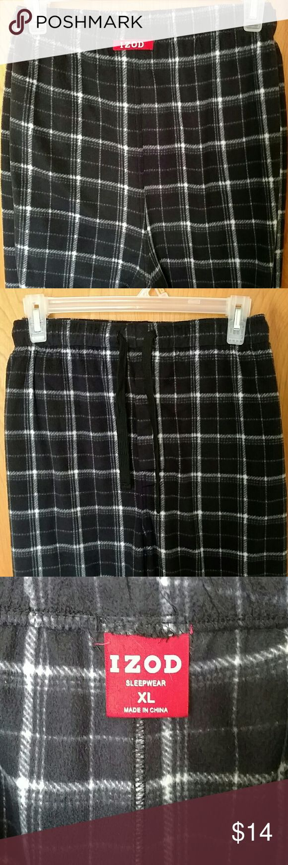 IZOD Men's Soft Sleep Pants IZOD brand men's sleep pants. Warm, soft, thick and fashionable! Black, white and gray plaid. Perfect to keep you warm and cozy as you lounge or sleep. Features drawstring and elastic at waist, a button fly, and side pockets. 100% polyester. Excellent condition. From a smoke free home. Izod Pants Sweatpants & Joggers