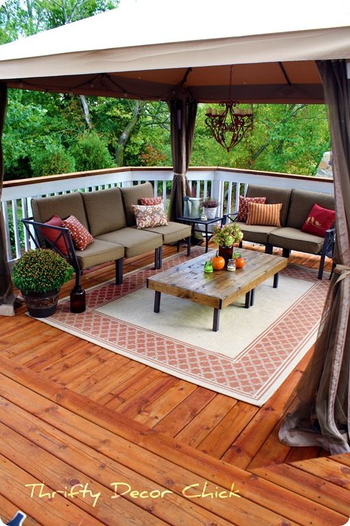 What a lovely, outdoor living room! Could be done pretty simply and inexpensively too with garage saleing and the like! ONE Change? Make sure all absorbant sufaces are switched out for non absorbant, weather friendly ones!