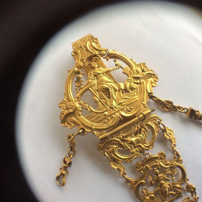 Catawiki, pagina di aste on line  Pendaglio porta orologio in metallo dorato