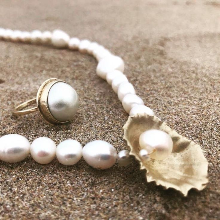 Pearl necklace and gold pearl ring. Available from Ardmorejewellery.com #gold #necklace #ring #pearl #sand #sea #beach #jewellery #classic #beautiful #inspiration #shell #oyster