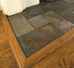 Slate to wood floor transition... I like the idea of using slate at the entry, hearth, & kitchen. Possible slate in bathrooms & laundry room also.