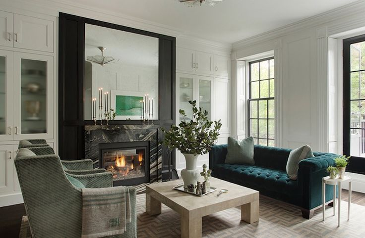 Love the Teal Sofa. Love the elegance of this living room from nina Farmer Interiors