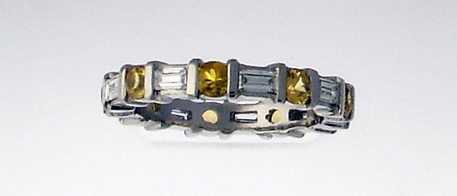 Platinum eternity ring with baguette diamond and yellow sapphires.  Comment or email jeff@premiergems.ca for details.