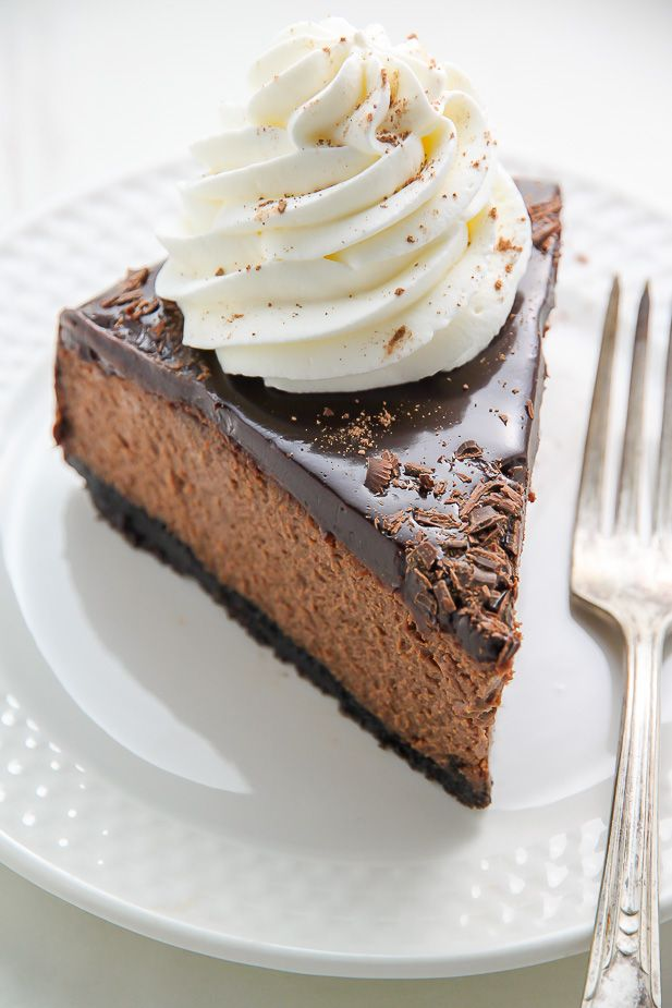 Oreo Crusted Chocolate Cheesecake topped with Chocolate Ganache and spiked with Kahlua... need I say more?!