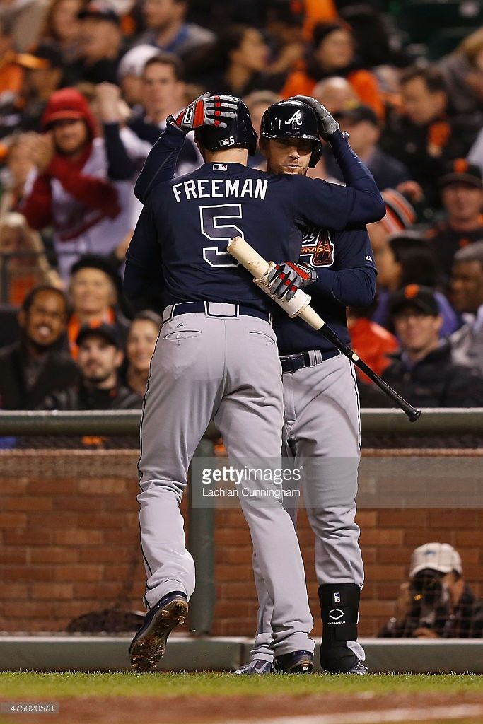 Freddie Freeman Of The Atlanta Braves Celebrates With Chris Johnson After Hitting A Solo Home Run In Ninth Inning Against San