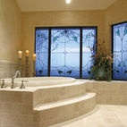 bath tile and floor tile - tile squares a bit smaller around tub - like the step!