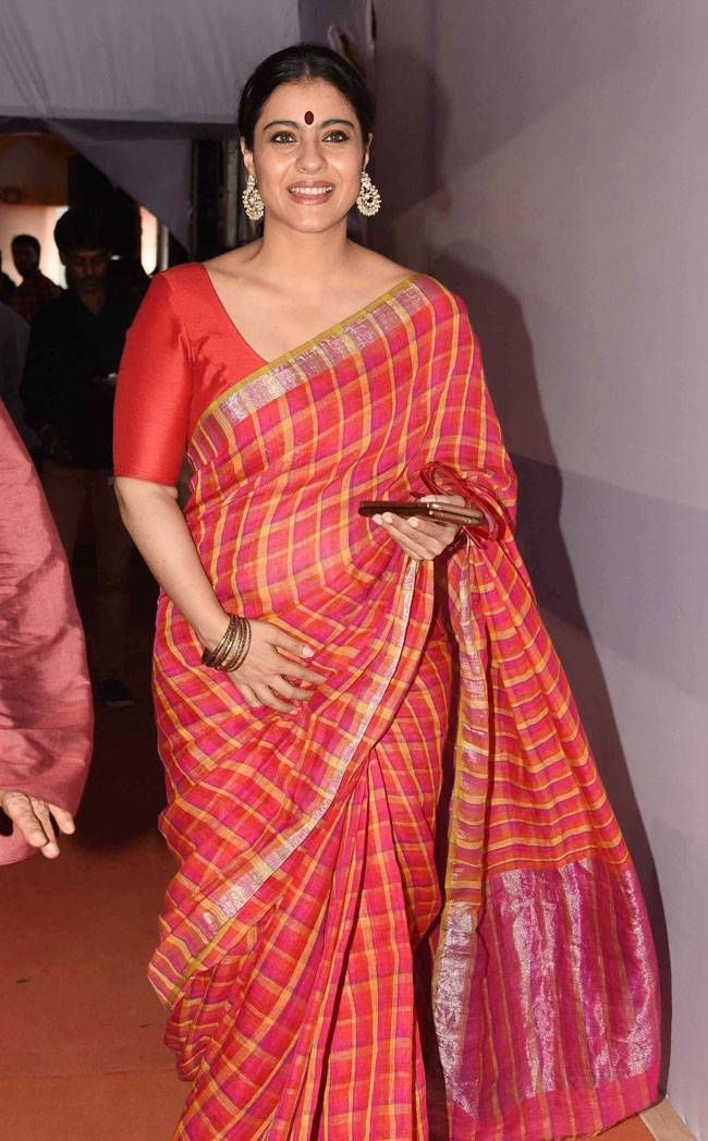 Kajol in a check silk sari at Durga Puja celebrations