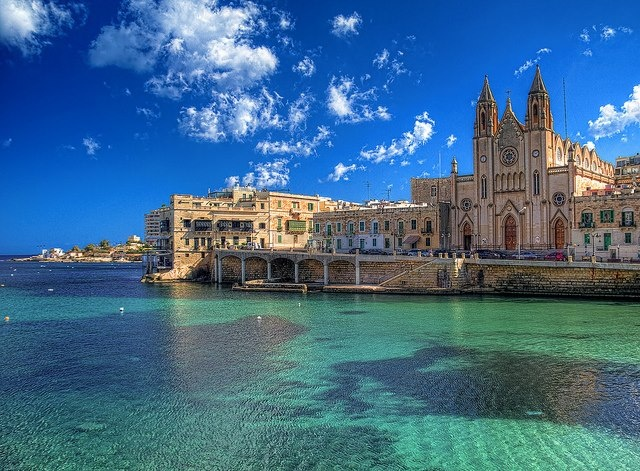 Balluta Bay, St.Julians (Malta).  Oh to be a five minute walk from here again...