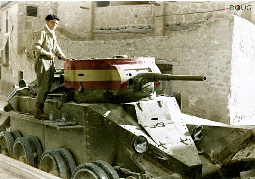 During the Spanish Civil War - One of Franco's Nationalist soldiers on a captured Republican (Russian) BT.5 tank - Fuentes de Ebro - 1938