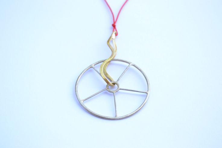 Handmade pendant wheel. by Efstathia.