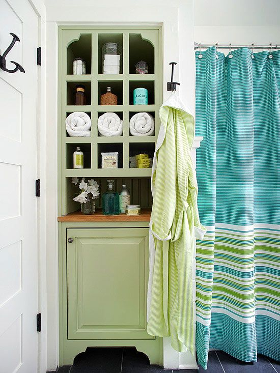 Aqua + Spring Green + White: In this bathroom, a built-in hutch stands out as something truly special, thanks to a coat of fresh green paint. Nearby, a striped shower curtain features a similar green as well as a cheerful blue. The walls in the bathroom were left white to allow easy transitions as the homeowners' decorating tastes change.