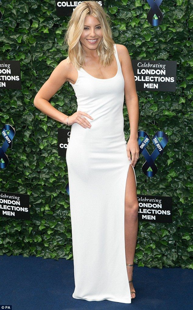 Blonde bombshell: Mollie King wowed in a clinging white gown which had a thigh-high split ...