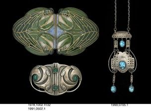 Waist-clasp; porcelain set in silver-gilt; shallow relief decoration: 4 dragonflies in blue and green underglaze colours; gold lining defining edges; marked on reverse; impressed monogram; stamped on silver mount; original leather case.