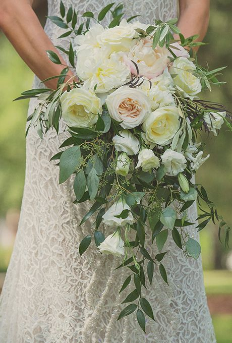 Cascading Blush Bouquet of Garden Roses, Peonies, and Greenery. Jessica and Michael's charming wedding in Bluffton, South Carolina was practically brimming with gorgeous blooms. The bride's bouquet was no exception. She chose a cascading arrangement (a replica of her late mother's wedding flowers!) comprised of garden roses, peonies, and lush greenery, created by Em. Creative Floral.