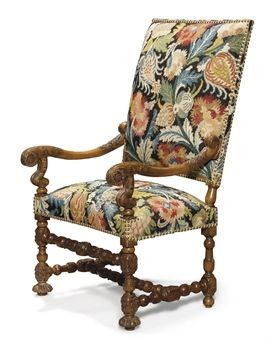 A PAIR OF LOUIS XIII TURNED AND CARVED-WOOD ARMCHAIRS FIRST HALF 17TH CENTURY Each with shaped arms decorated with sunflowers and supported by foliage-carved uprights, the legs joined by stretchers, upholstered with floral-patterned point needlework $63,167.00