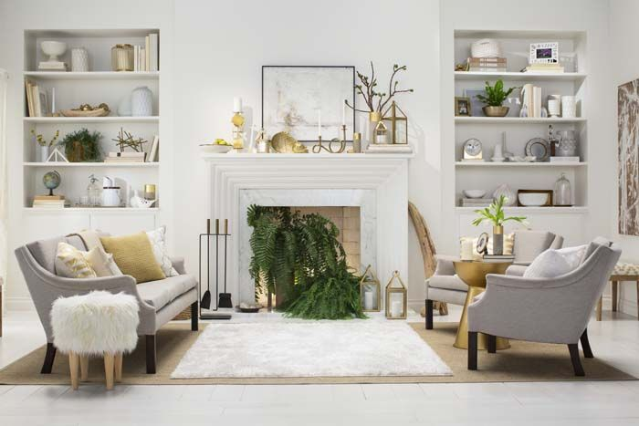 A gold and green fireplace, styled by Emily Henderson