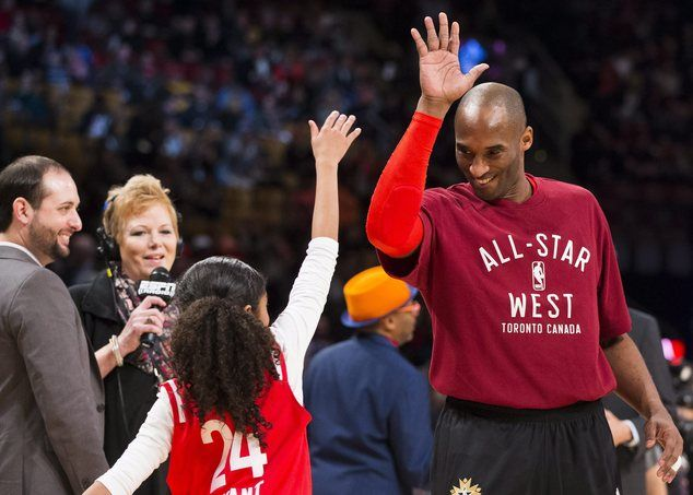 Los Angeles Lakers' Kobe Bryant (24) high-fives his daughter before the first half of the NBA all-star basketball game, Sunday, Feb. 14, 2016 in Toronto. (Mark Blinch/The Canadian Press via AP) MANDATORY CREDIT