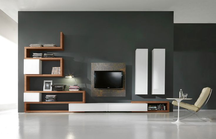 SIDE SYSTEM 31 - Living cabinet with drawers base unit, big vertical wall units combined with turning elements between shelves in walnut. Tv stand with front in Stone veneer. http://www.fimarmobili.com