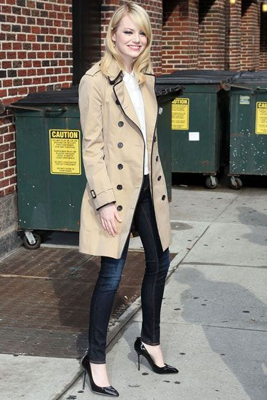 Emma Stone takes a ladylike approach in a Burberry trench, dark skinnies and black pumps