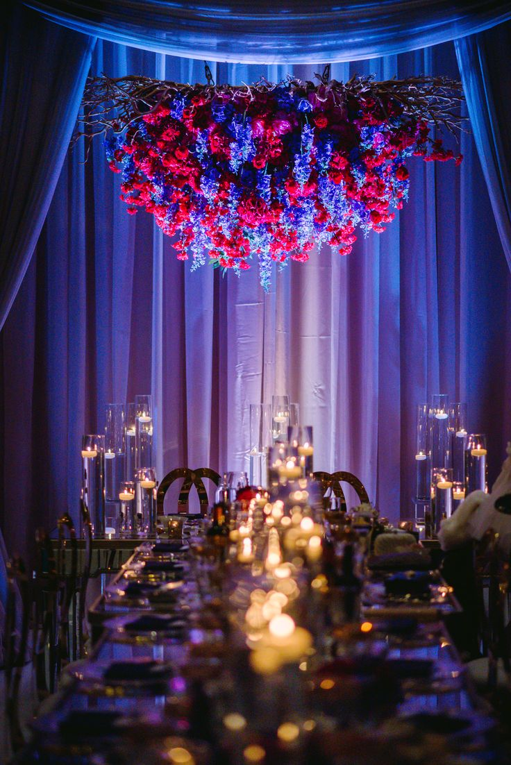 For the bride that dares to be different! Decor: @fos_decor Floral: @fos_decor Photo: julianmoniz Eventplaner: Anna R @fos_decor Venue: Embassy grand   #wedding #weddingdecor #flower #votive #drapping #blue #red #purple #candle #candlelight #candleholder #bride #hangingflower #dinning #fos #fosdecor #fosrentalgroup #rental #weddingstyle #weddinginspiration #weddingideas