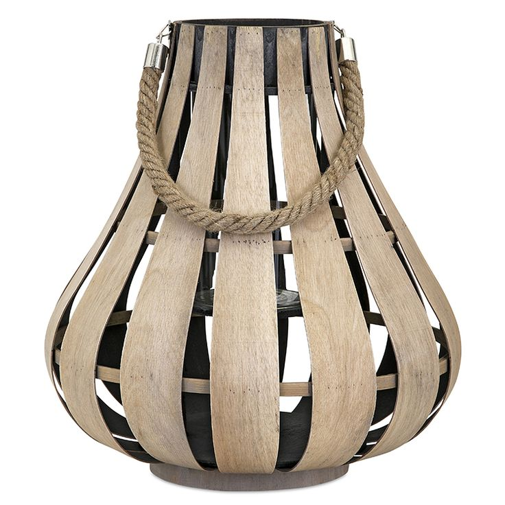 """The Cade lantern is perfect for a coastal getaway or Scandinavian-inspired home. This small lantern in a natural wood tone has a decorative rope handle and holds one pillar candle (not included). Dimensions: 13"""" in diameter x 22.5""""H"""