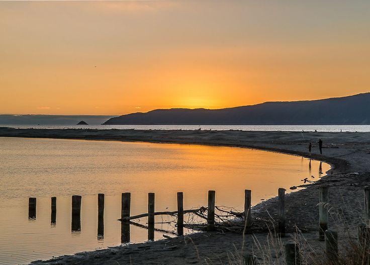 Waikanae Estuary as the sun dips behind Kapiti Island, Kapiti Coast, New Zealand Ref No: NZNK169195