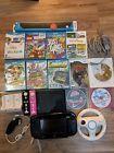 Nintendo Wii U Deluxe 32GB Black Handheld System bundle W/ Games