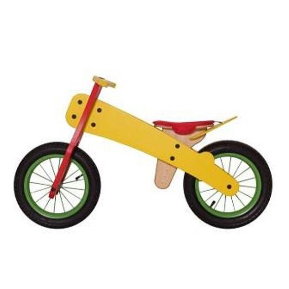 Balance bike. Wooden runbike.  The surface is treated with environmentally and child friendly linseed oil instead of varnish. Lightweight but strong. Weighs only 3.9 kg. The seat is easily and infinitely adjustable between 34 cm – 45 cm. Seat pad made from durable fabric and is removable for washing. Unique steering joint prevents to extreme direction changes and a crimping of the fingers provided added stability and safety. Run bike has 12'' wheels, which are very strong and simple and come…