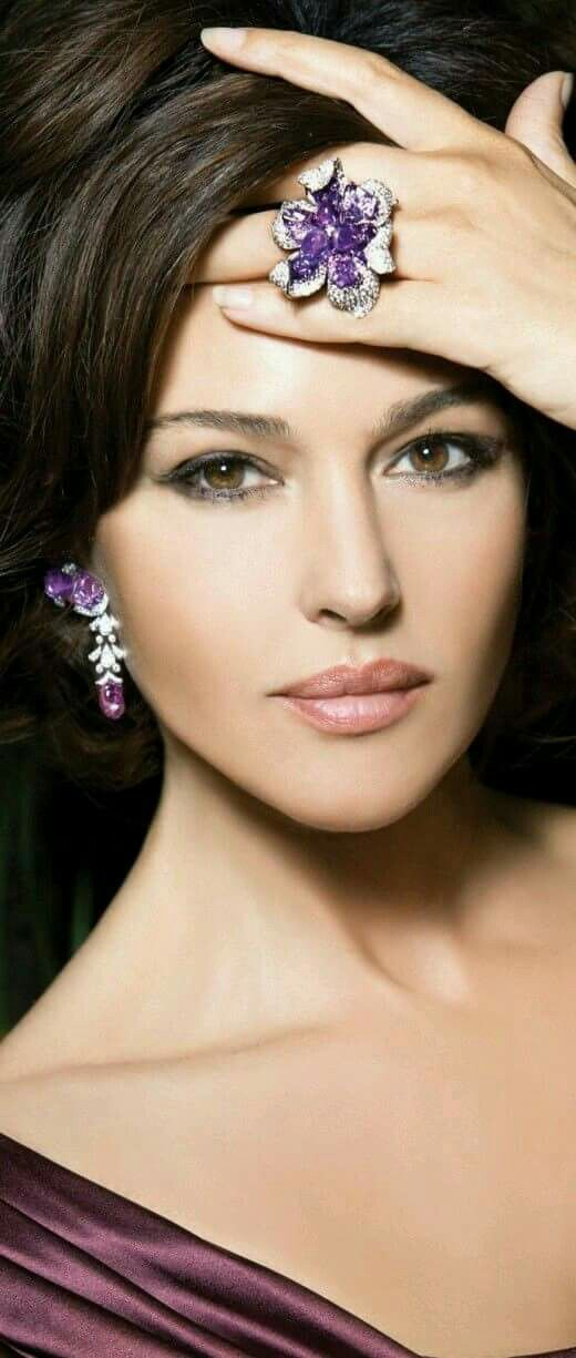 Monica Bellucci. Her beauty outshines even the gorgeous bling she's wearing.