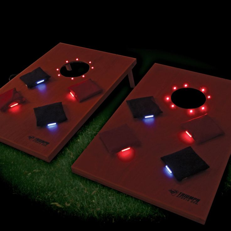 Triumph Sports LED Glow Cornhole Set - With the Triumph Sports LED Glow Bean Bag Toss, never again will darkness put a premature end to your backyard showdowns. This innovative bean bag tos...