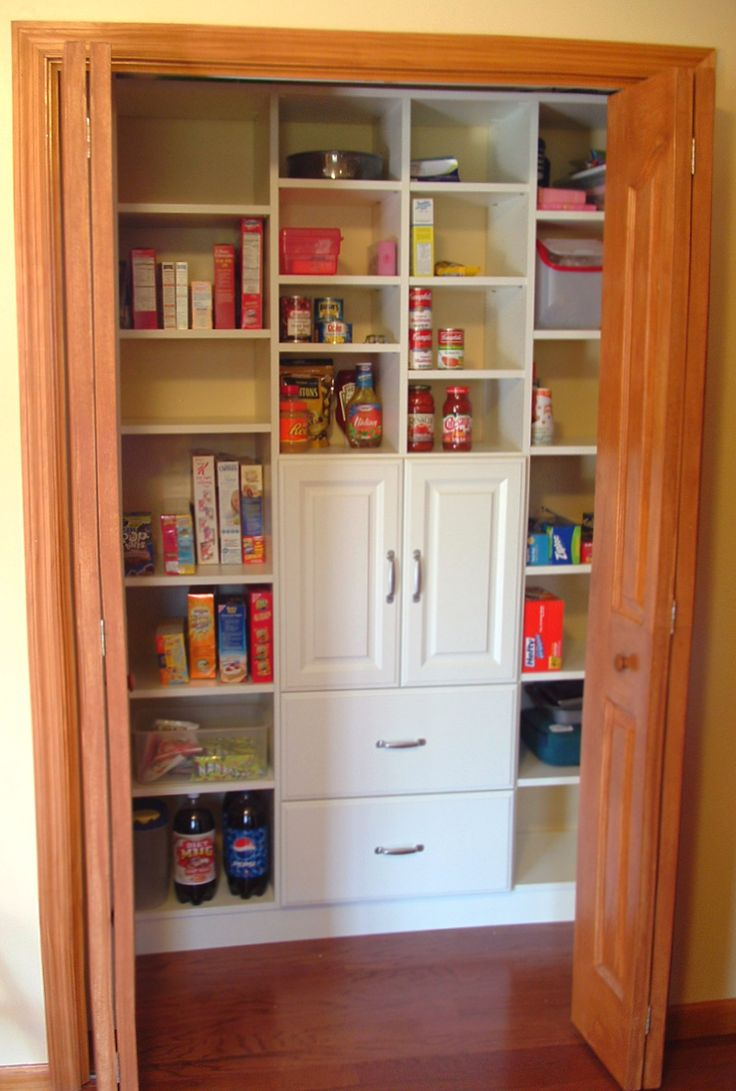 Reach-in utility closet turned into a fantastic kitchen pantry! www.closetcity.com
