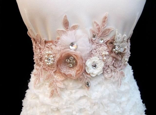 This blush pink sash has been decorated with rhinestone, pearl beads and tulle, silk, organza, crochet ivory flowers.The bridal applique measures