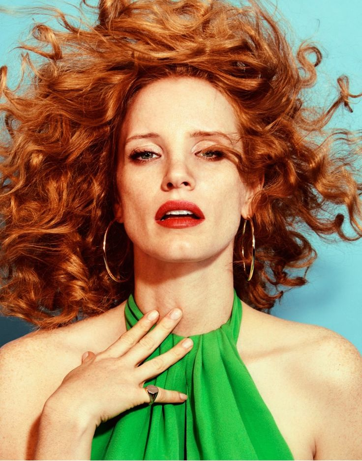 Wearing her hair in bold curls, Jessica Chastain poses in Emilio Pucci dress and Jennifer Fisher earrings for The Edit Magazine December 2016