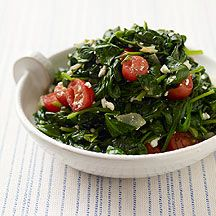 Spinach with Tomatoes and Feta  1 1/2 tsp olive oil          3/4 cup(s) (chopped) uncooked onion(s), chopped        2 tsp minced garlic          18 oz fresh spinach, baby leaves        1/4 tsp table salt          1 cup(s) grape tomatoes, cut in half        1/2 cup(s) crumbled feta cheese