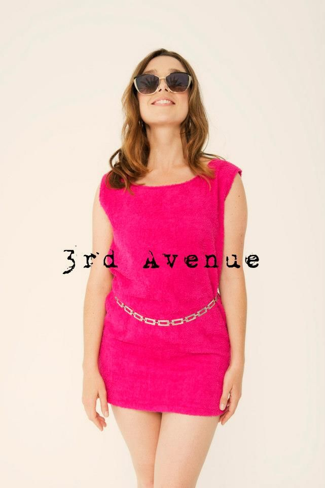 """Sylvia wears """"Newport"""" shift dress in """"Shocking Pink"""" with contrasting blue back zip. 100% cotton terry towelling fabric. (belt not included) Sizes made to order. Colours subject to availability"""