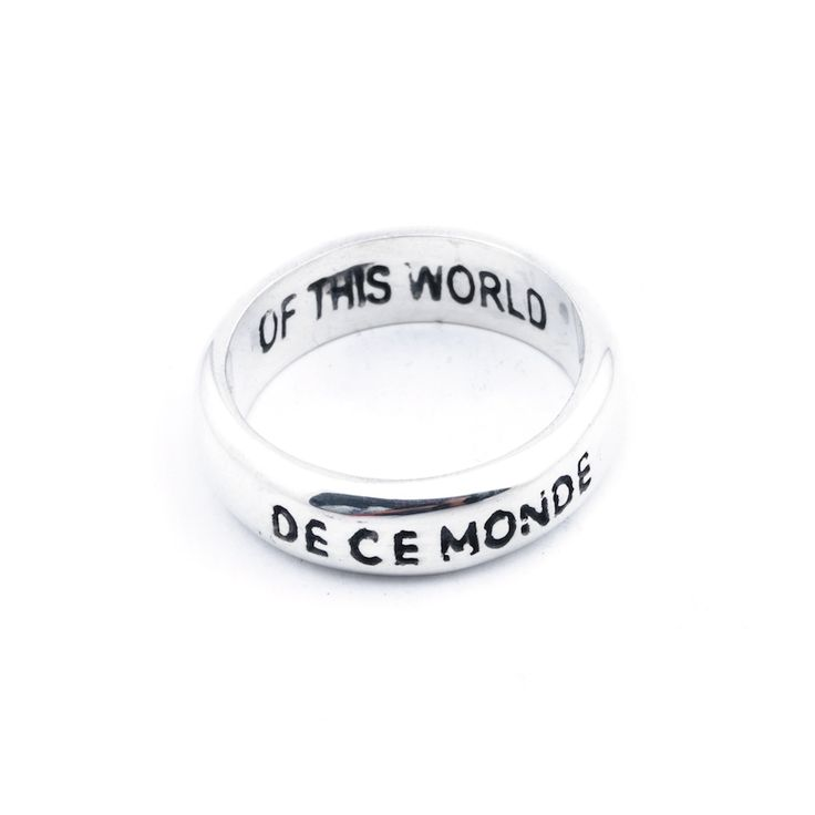 De Ce Monde Classic ring - $90. Classic shaped single curved ring crafted in 100% pure 925 sterling silver, inscribed with 'De Ce Monde' on the exterior, and 'Of This World' on the interior. Lovingly designed by Australian designer label Celeste Tesoriero, and handcrafted in Indonesia. www.savethelastpinker.com.au/shop/de-ce-monde-classic-ring/
