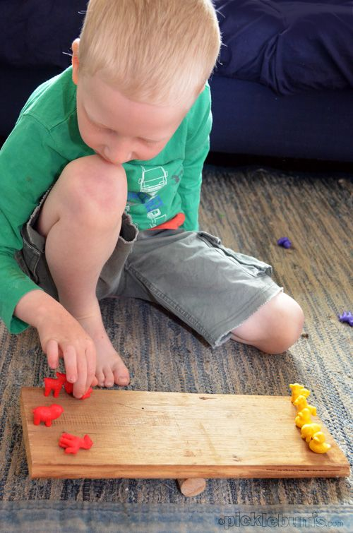 A DIY balance teaches children about weighing and measuring.