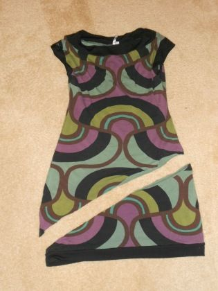 Awesome blog where she takes old goodwill finds and turns them into cute new clothes :) Ideas are flying right now!