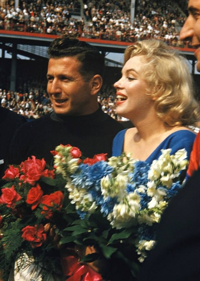 Marilyn Monroe - May 12, 1957 - at the Dodgers Ebbets Field, New York - where she made the ceremonial first kick in a soccer match between the USA national team and the Israeli club Hapoel Tel Aviv - beside her is the famous Israeli goalkeeper Ya'acov Chodorov