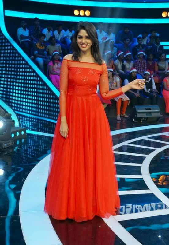 Nyla Usha in red gown